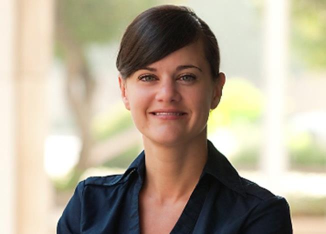 Nicole R. Kint